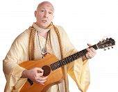bald swami with guitar