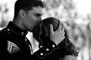 FIRST VIGIL--soldier kisses girlfriend's forehead